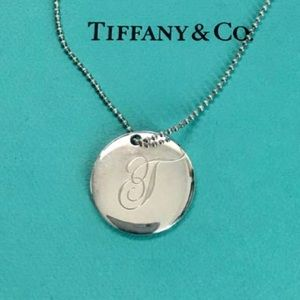 """Tiffany & Co. Silver LG Initial """"T"""" Disc Necklace."""